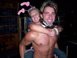 Topless Waiter carrying the hen at a hens party