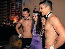 Topless Waiters posing with hens party girls at mofo lounge